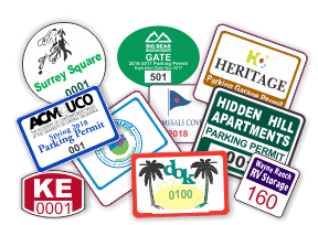 Array of colorful decals with serial numbers and business logo in a variety different shapes, sizes, and formats.
