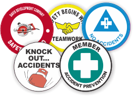 Array of colorful safety decals with serial numbers and business logo in a variety different shapes, sizes, and formats.