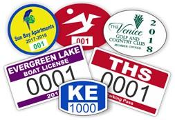 Array of colorful bumper stickers with serial numbers and business logo in a variety different shapes, sizes, and formats.