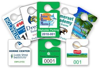 Array of colorful hang tags with serial numbers and business logo in a variety different shapes, sizes, and formats.
