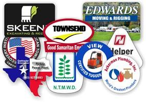 Array of colorful parking hang tags and permits with serial numbers and business logo in a variety different shapes, sizes, and formats.
